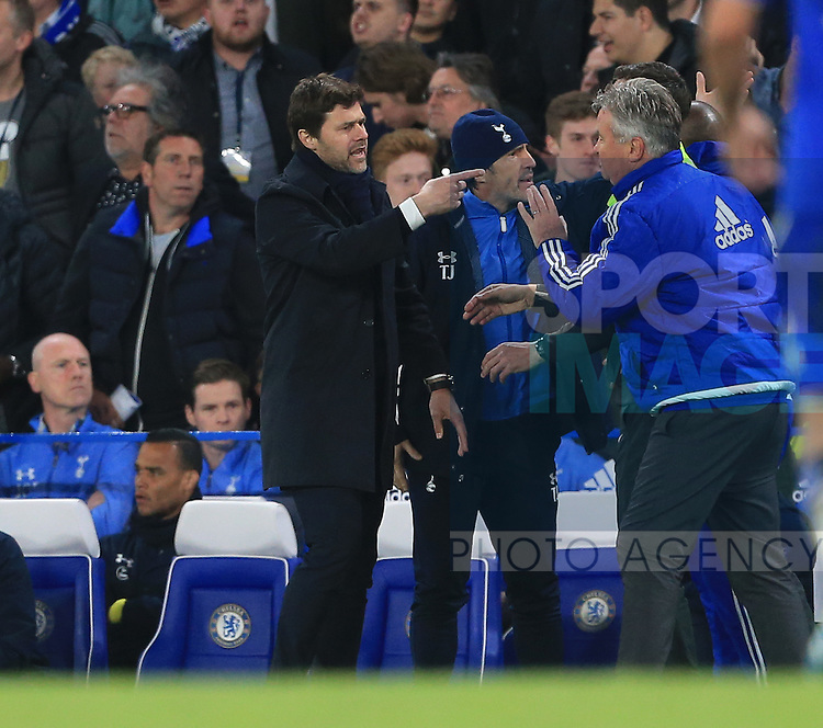Chelsea's Guus Hiddink argues with Tottenham's Mauricio Pochettino during the Barclays Premier League match at Stamford Bridge Stadium.  Photo credit should read: David Klein/Sportimage