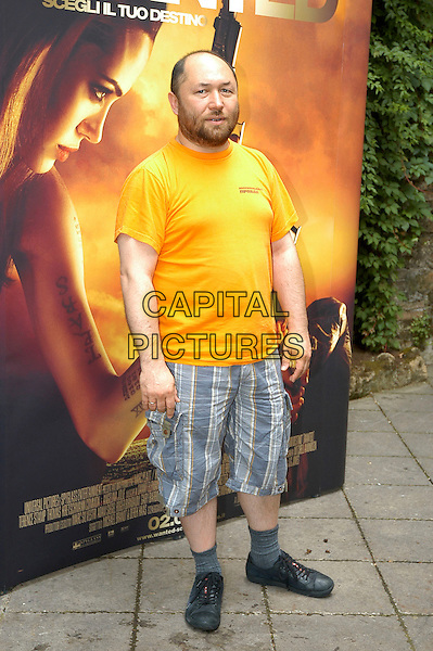 "TIMUR BEKMAMBETOV.Photocall for thhe film ""Wanted"", Rome, Italy..June 11th, 2008.director full length orange yellow t-shirt beard facial hair blue shorts socks trainers sneakers .CAP/CAV.©Luca Cavallari/Capital Pictures."