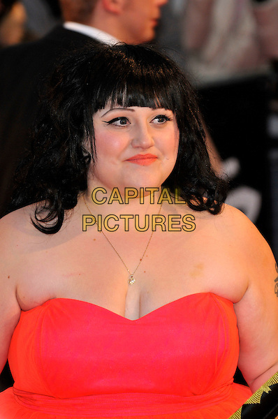 BETH DITTO - THE GOSSIP.The Brit Awards 2008, arrivals.Earl's Court, London, England.20th February 2008.Ref: CAP/PL.brits half length cleavage pink strapless dress.www.capitalpictures.com.©Phil Loftus/Capital Pictures.
