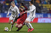 Columbus, Ohio - Thursday March 01, 2018: Lena Goeßling, Savannah McCaskill, Dzsenifer Marozsán during a 2018 SheBelieves Cup match between the women's national teams of the United States (USA) and Germany (GER) at MAPFRE Stadium.