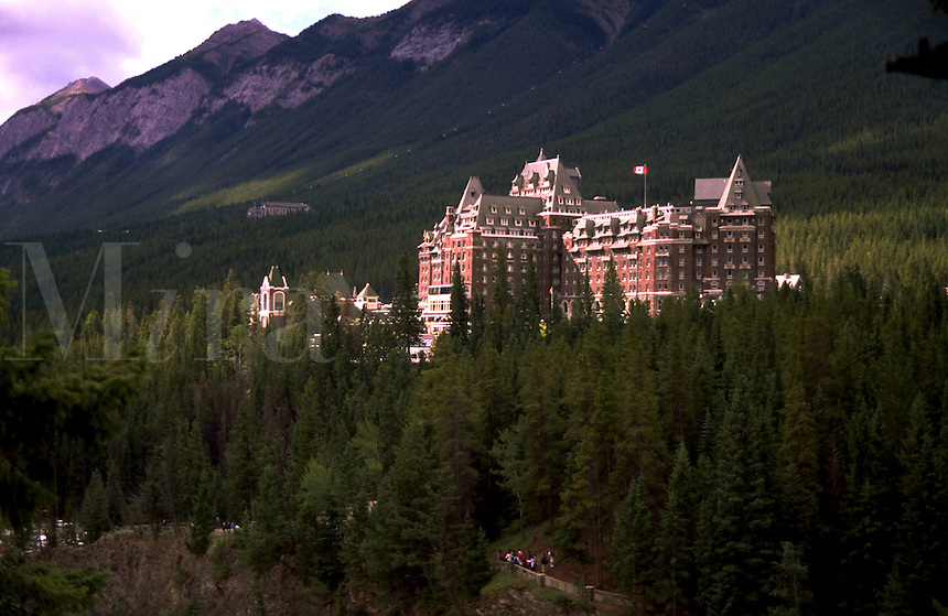 The exterior of the Banff Springs Hotel, surrounded by mountains and forest. Banff National Park, Alberta, Canada.