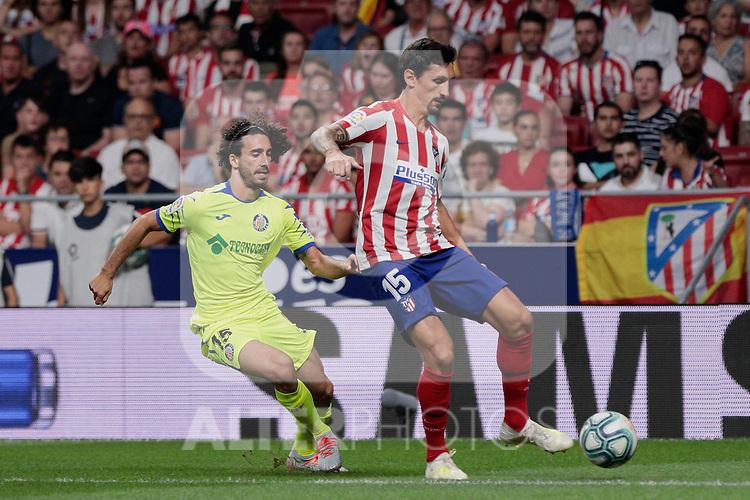 Atletico de Madrid's Stefan Savic and Getafe CF's Marc Cucurella during La Liga match between Atletico de Madrid and Getafe CF at Wanda Metropolitano Stadium in Madrid, Spain. August 18, 2019. (ALTERPHOTOS/A. Perez Meca)