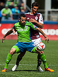 Seattle Sounders' Marco Pappa, left, is guarded by Colorado Rapids' Thomas Piermayr during an MLS match on April 26, 2014 in Seattle, Washington.  The Seattle Sounders beat the Colorado Rapids 4-1.  Jim Bryant Photo. ©2014. All Rights Reserved.