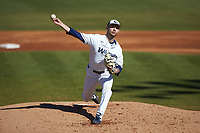 Wingate Bulldogs starting pitcher Austin Mitchell (16) in action against the Concord Mountain Lions at Ron Christopher Stadium on February 2, 2020 in Wingate, North Carolina. The Mountain Lions defeated the Bulldogs 12-11. (Brian Westerholt/Four Seam Images)