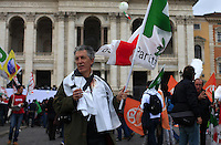"""Italy, Rome, November 5, 2011..A Italy demonstrator of the Centre-lef party (Democratic Party) carries a banner that reads """"Berlusconi human misery get out""""while he takes part in a rally against the government of Italian Prime Minister Silvio Berlusconi at the at the San Giovanni square in Rome November 5 , 2011. VIEWpress / Kena Betancur.Italy's opposition crowded few street of Rome during a rally on Saturday demanding Silvio Berlusconi's resignation, the opposition """"DP"""" is accusing the prime minister of dragging the country into bankruptcy and global shame. International newspapers reported."""