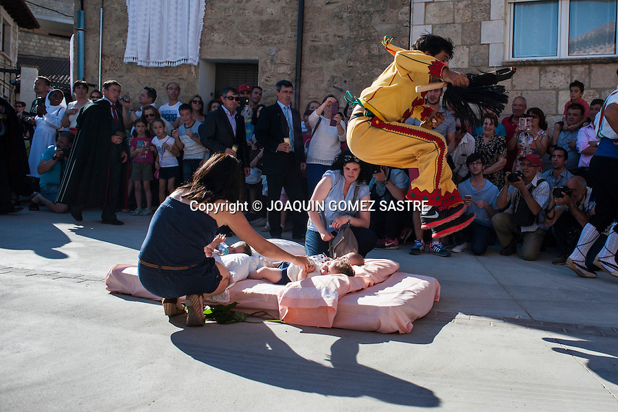 The streets of Castrillo de Murcia (Burgos) are filled mattresses where mothers put the babies born during the year for the jump The colacho