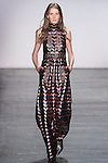 "Model Helga walks runway in a sequin zig zag sleeveless gown with talismanic applique, from the Vivienne Tam Fall Winter 2016 ""Cultural Dreamland The New Silk Road"" collection, presented at NYFW: The Shows Fall 2016, during New York Fashion Week Fall 2016."