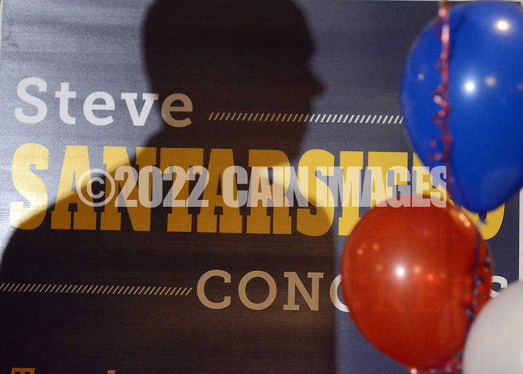 Steve Santarsiero's shadow is cast on a campaign sign as he addresses supporters during a victory celebration after he won the democratic nomination in the 8th district senate race at Temperance House April 26, 2016 in Newtown, Pennsylvania.  (Photo by William Thomas Cain)