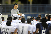 12 August 2011:  FIU Football Head Coach Mario Cristobal addresses his players after a scrimmage held as part of the FIU 2011 Panther Preview at University Park Stadium in Miami, Florida.