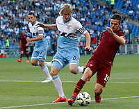 Calcio, Serie A: Lazio vs Roma. Roma, stadio Olimpico, 25 maggio 2015.<br /> Roma's Miralem Pjanic, right, is challenged by Lazio's Dusan Basta during the Italian Serie A football match between Lazio and Roma at Rome's Olympic stadium, 25 May 2015.<br /> UPDATE IMAGES PRESS/Riccardo De Luca