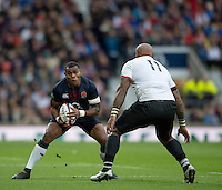 Twickenham, United Kingdom.  England&rsquo;s, Semesa ROKOUGUNI, faces, Fijian, Nemani NADOLO, during the Old Mutual Wealth Series Rest Match: England vs Fiji, at the RFU Stadium, Twickenham, England, Saturday  19/11/2016<br />