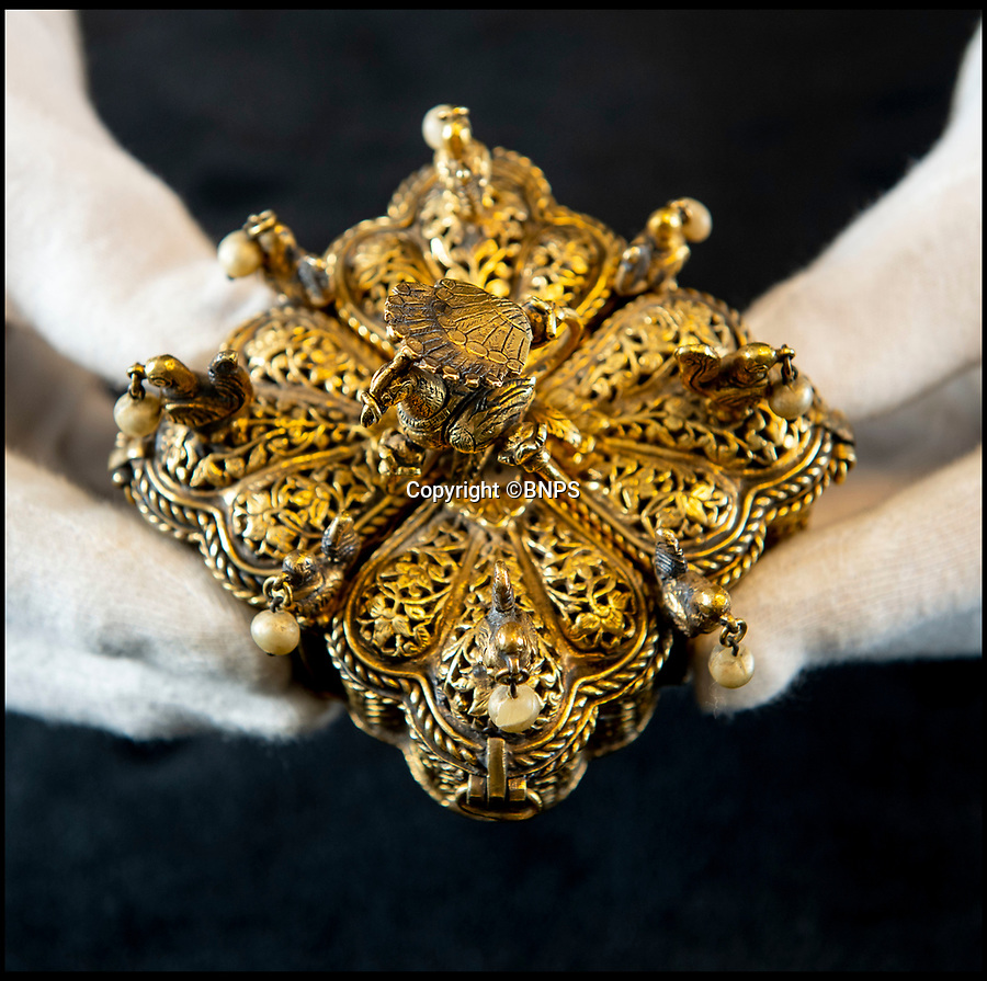 BNPS.co.uk (01202) 558833<br /> Pic: PhilYeomans/BNPS<br /> <br /> Tipu Sultan's ornate solid gold betel nut casket - amazingly still containing 220 year old nuts. <br /> <br /> Stunning artefacts from Indian hero Tipu Sultan's fateful last stand have been rediscovered by the family of an East India Company Major who took part in the famous battle that ended his reign.<br /> <br /> And now Major Thomas Hart's lucky descendents are likely to become overnight millionaires after retrieving the historic items from their dusty attic.<br /> <br /> The fascinating treasures were taken from Tipu's captured fortress of Seringapatam in the wake of his defeat by British forces led by a young Duke of Wellington in 1799.<br /> <br /> The cache of ornate gold arms and personal effects even include's the battle damaged musket the Sultan used in his fatal last stand against the expanding British Empire in India.<br /> <br /> Tipu was last seen on the battlements of the fortress firing his hunting musket at the advancing British and after the fierce encounter his body was found bearing many wounds, including a musket ball shot above his right eye.<br /> <br /> The rediscovered musket, complete with battle damaged bayonet, has the distinctive tiger stripe pattern unique to the self styled Tiger of Mysore own weapons - and tellingly there is also shot damage to the lock and stock that may have been caused by the musket ball that finished him off.<br /> <br /> Also included in the sale are four ornate gold-encrusted sword's bearing the mark of Haider Ali Khan, Tipu's father and the previous ruler of independent Mysore, along with a solid gold 'betel casket' complete with three 220 year old nuts still inside.<br /> <br /> The war booty was brought back to Britain by Major Thomas Hart of the British East India Company following the fourth and final Anglo-Mysore war.<br /> <br /> They have been passed down through the family ever since and now belong to a couple who have kept them wrapped