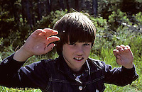 FS11-003z  Boy swatting blackflies and mosquitoes.