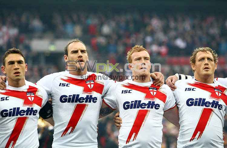 PICTURE BY VAUGHN RIDLEY/SWPIX.COM - Rugby League - Gillette 4 Nations 2011 - England v Australia - Wembley Stadium, London, England - 5/11/11 - England's Kevin Sinfield, Gareth Ellis, Jack Reed and Ben Westwood sing National Anthem.