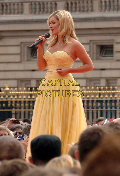 KATHERINE JENKINS .Performing live at the VISA London 2012  Olympic Handover Party, a free concert attended by 40,000 people in The Mall, London, England, 24th August 2008. .gig live on stage half length strapless yellow dress union jack flag .CAP/DS.©Dudley Smith/Capital Pictures