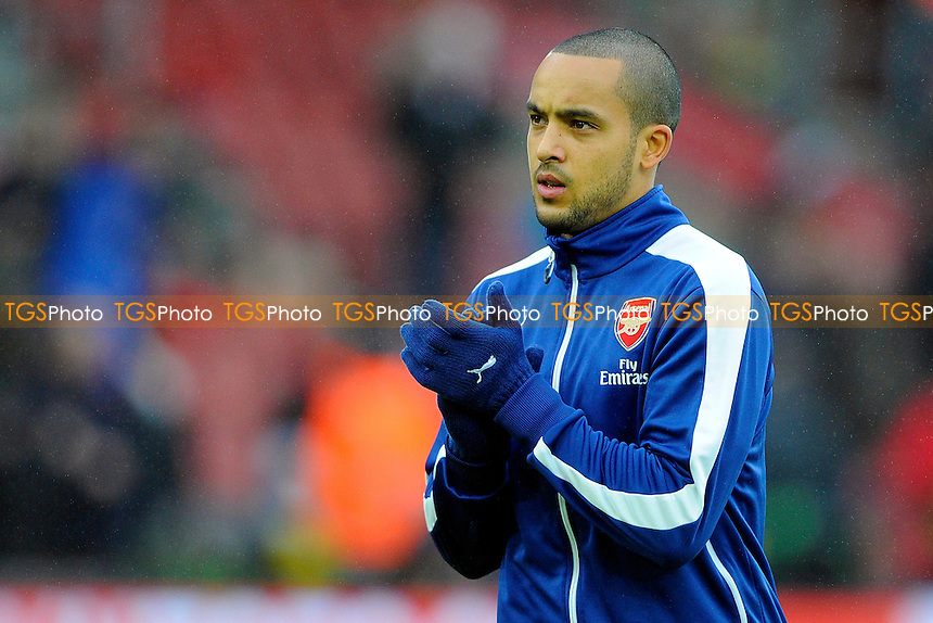 Theo Walcott of Arsenal in the warm up - Southampton vs Arsenal - Barclays Premier League Football at St Mary's Stadium, Southampton, Hampshire - 01/01/15 - MANDATORY CREDIT: Denis Murphy/TGSPHOTO - Self billing applies where appropriate - contact@tgsphoto.co.uk - NO UNPAID USE
