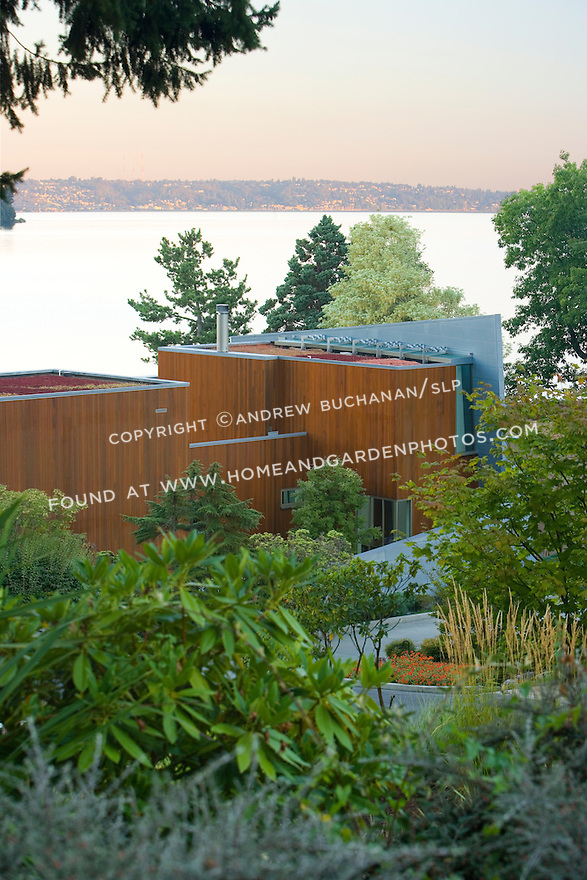 "Environmentally responsible buildings pay attention to exterior surfaces as well.  Here, a ""green roof"" on a modern, architecturally-designed, luxury waterfront home by Seattle architects Olson, Sundberg, Kundig, Allen (OSKA Architects) catches, slows, and filters runoff, thus moderating and cleaning the runoff before it empties into nearby Lake Washington."