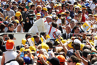 Papa Francesco saluta un bambino al suo arrivo all'udienza generale del mercoledi' in Piazza San Pietro, Citta' del Vaticano, 26 giugno 2013.<br /> Pope Francis greets a child as he arrives for his weekly general audience in St. Peter's Square at the Vatican, 26 June 2013.<br /> UPDATE IMAGES PRESS/Isabella Bonotto<br /> <br /> STRICTLY ONLY FOR EDITORIAL USE