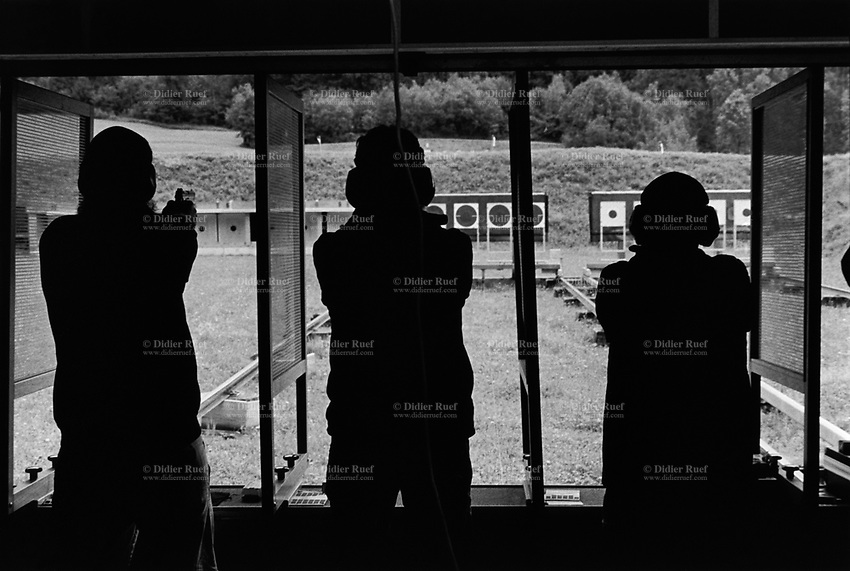 Switzerland. Canton Glarus. Glarus. Cantonal shooting fair. Three men aim and shoot with their pistols on targets distant 25 meters.19.08.2017 © 2017 Didier Ruef