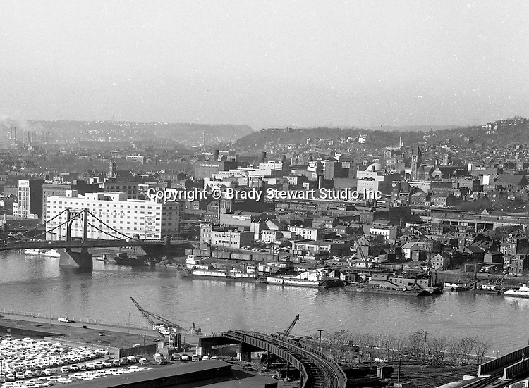 Pittsburgh Pa:  View of the North Side and bridges from the Penn Station roof - 1959.  View includes the 9th street bridge, B&O Railroad building and the destruction of the railroad tracks from Penn Station to the Wabash terminal to make way for Fort Duquesne Boulevard.