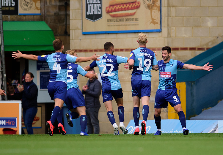 Wycombe Wanderers' Joe Jacobson (3) celebrates scoring the opening goal with team-mates<br /> <br /> Photographer Andrew Vaughan/CameraSport<br /> <br /> The EFL Sky Bet League One - Wycombe Wanderers v Lincoln City - Saturday 7th September 2019 - Adams Park - Wycombe<br /> <br /> World Copyright © 2019 CameraSport. All rights reserved. 43 Linden Ave. Countesthorpe. Leicester. England. LE8 5PG - Tel: +44 (0) 116 277 4147 - admin@camerasport.com - www.camerasport.com