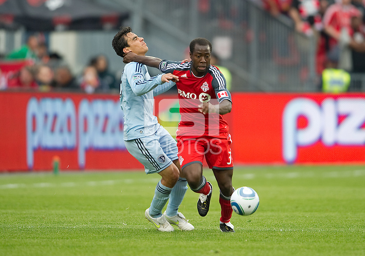 Sporting KC forward Omar Bravo #99 and Toronto FC defender Nana Attakora #3 in action during an MLS game between Sporting Kansas City and the Toronto FC at BMO Field in Toronto on June 4, 2011...