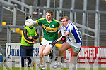 Greg Horan Kerry goes past Brian Looby Waterford during their Minor semi final in Killarney Wednesday evening