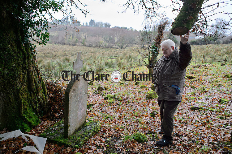 Flan Broderick at the grave of his uncle Tommy in Keane's Kyle, Derreendogh, Gortaveha, Killanena, who was accidentally shot in his home, aged six and a half, in 1923 during the course of his brothers' jailbreak from Caher police station. Photograph by John Kelly.
