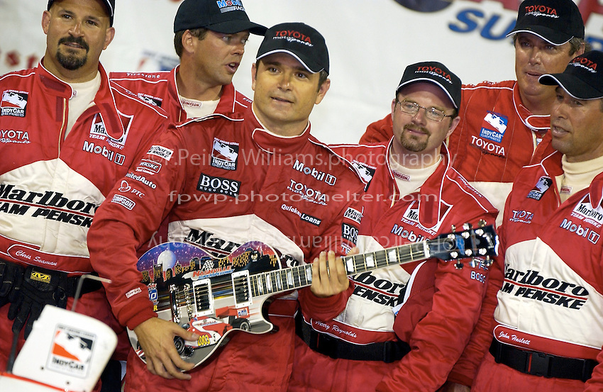 """IRL IndyCar Series Firestone Indy 200 at Nashville Superspeedway, Nashville,Tennesee, USA 19 July,2003.Gil de Ferran with his """"trophy"""", a Gibson Les Paul..World Copyright©F.Peirce Williams 2003 .ref: Digital Image Only..F.Peirce Williams Photography.20517-J Sterling Bay Lane West  Cornelius,NC 28031 USA.phone: 704.892.9104 mobile: 937.367.4401 .email: FPWPhoto@aol.com   www.fpwp.com.."""