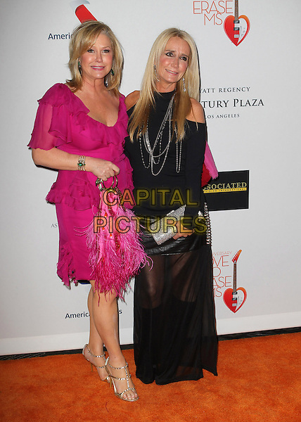 Kathy Hilton, Kim Richards.20th Annual Race To Erase MS Gala held at the Hyatt Regency Century Plaza Hotel, Century City, California, USA, 3rd May 2013..full length pink dress ruffles cut out shoulders  black  sister siblings family couple sheer long maxi leather skirt feather bag silver chains .CAP/ADM/KB.©Kevan Brooks/AdMedia/Capital Pictures