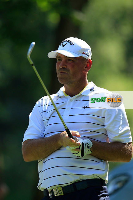 Thomas Bjorn (DEN) tees off the par3 17th tee during Thursday's Round 1 of the 2013 BMW International Open held on the Eichenried Golf Club, Munich, Germany. 20th June 2013<br /> (Picture: Eoin Clarke www.golffile.ie)