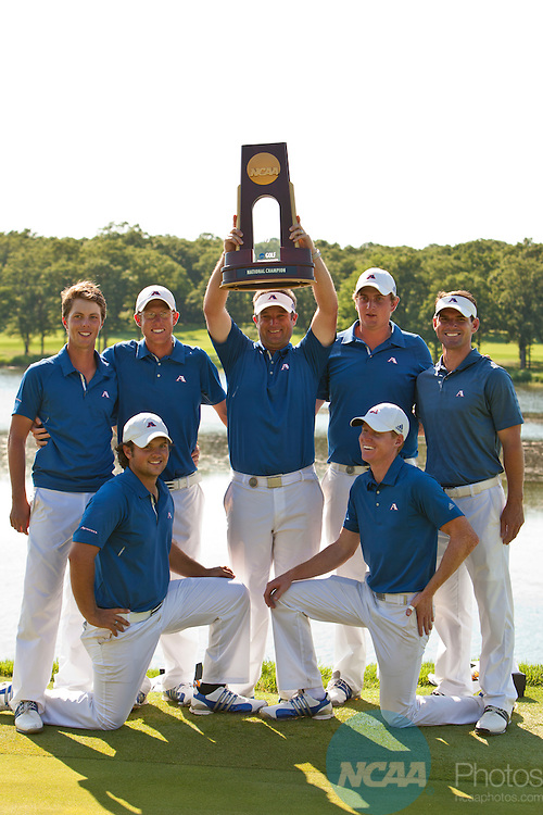 05 JUNE 2011:  Head coach Josh Gregory (center) and the rest of the Augusta State men's golf team pose with the trophy after winning the Division I Men's Golf Championship held at the Karsten Creek Golf Course in Stillwater,OK. Augusta State won the match play tournament 3-2 over Georgia.  Shane Bevel/NCAA Photos