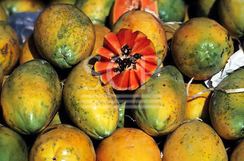Brazil. Papaya - 'Mamao' (Carica papaya) cut open to show seeds and flesh.