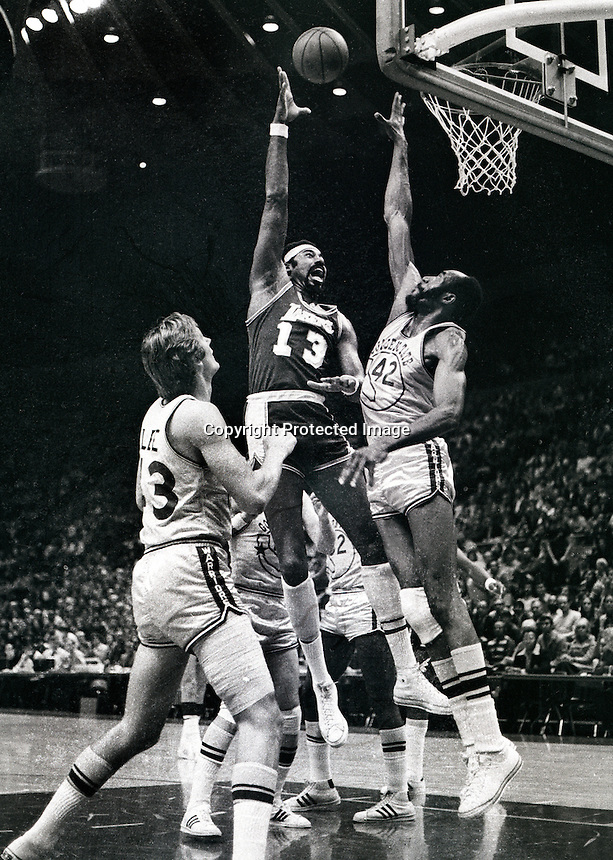 Los Angeles Laker Wilt Chamberlain shoots over Golden State Warrior Nate Thurmond, Clyde Lee on the left. (1967 photo by Ron Riesterer)