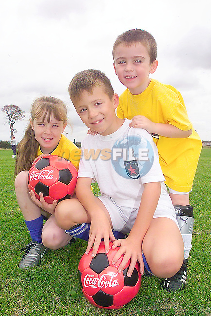 Shauna Newman, Mark Brady and Arron Murray-DyasJ taking part in the Tom Burke Memorial Soccer Camp in Rathmullen sponsored by Drogheda Concentrates.Photo Fran Caffrey/Newsfile.ie..This picture has been sent to you by:.Newsfile Ltd,.3 The View,.Millmount Abbey,.Drogheda,.Co Meath..Ireland..Tel: +353-41-9871240.Fax: +353-41-9871260.GSM: +353-86-2500958.ISDN: +353-41-9871010.IP: 193.120.102.198.www.newsfile.ie..email: pictures@newsfile.ie..This picture has been sent by Fran Caffrey.francaffrey@newsfile.ie