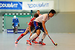 Mannheim, Germany, January 24: During the 1. Bundesliga Herren Hallensaison 2014/15 quarter-final hockey match between Mannheimer HC (white) and Club an der Alster (red) on January 24, 2015 at Irma-Roechling-Halle in Mannheim, Germany. Final score 2-3 (1-2). (Photo by Dirk Markgraf / www.265-images.com) *** Local caption *** Tino Nguyen #7 of Mannheimer HC