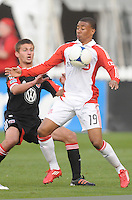 Toronto FC forward Reggie Lambe (19) shields the ball against D.C. United midfielder Perry Kitchen (23). D.C. United defeated Toronto FC 3-1 at RFK Stadium, Saturday May 19, 2012.