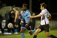 Omar Bogle of Grimsby Town and Jack Holland of Bromley during the Vanarama National League match between Bromley and Grimsby Town at Hayes Lane, Bromley, England on 9 February 2016. Photo by Alan  Stanford.