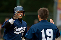 03 october 2009: Yann Dal Zotto of Savigny is congratulated by a teammate as he scores during game 1 of the 2009 French Elite Finals won 6-5 by Rouen over Savigny in the 11th inning, at Stade Pierre Rolland stadium in Rouen, France.