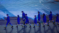 12 AUG 2012 - LONDON, GBR - Volunteers walk into position before the entrance of the flags and athletes during the London 2012 Olympic Games Closing Ceremony in the Olympic Stadium in the Olympic Park, Stratford, London, Great Britain .(PHOTO (C) 2012 NIGEL FARROW)
