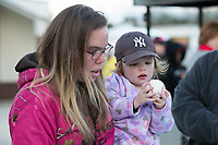 A young fan inspects the baseball that was just autographed by former Major League Baseball star Darryl Strawberry (not pictured) during the South Atlantic League game between the Lakewood BlueClaws and the Kannapolis Intimidators at Kannapolis Intimidators Stadium on April 6, 2017 in Kannapolis, North Carolina.  The BlueClaws defeated the Intimidators 7-5.  (Brian Westerholt/Four Seam Images)