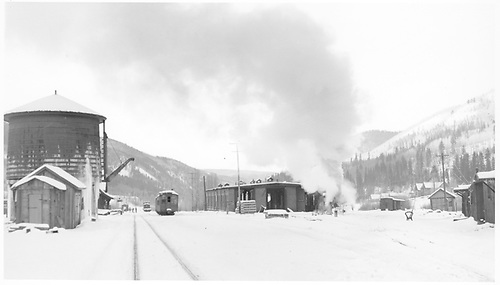 A partial south-facing view of the RGS Rico yards on a snowy day with miscellanous rolling stock and K-27 #461 at the north end of the engine house.<br /> RGS  Rico, CO  Taken by Richardson, Robert W. - 11/17/1951