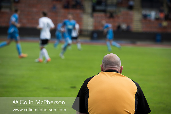 Berwick Rangers manager John Coughlin looks on during his team's visit to Edinburgh City in an SPFL2 fixture at Meadowbank Stadium. Despite taking the lead in the 66th minute through Ousman See's goal, City lost the game 2-1, watched by a crowd of 410 and remained without a point at the foot of the table after four League games.