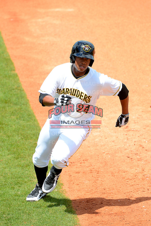 Bradenton Marauders designated hitter Willy Garcia #24 rounds third during a game against the Fort Myers Miracle at McKechnie Field on April 7, 2013 in Bradenton, Florida.  Fort Myers defeated Bradenton 9-8 in ten innings.  (Mike Janes/Four Seam Images)