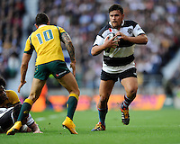Angus Ta'avao of Barbarians sizes up Quade Cooper of Australia during the Killik Cup match between Barbarians and Australia at Twickenham Stadium on Saturday 1st November 2014 (Photo by Rob Munro)