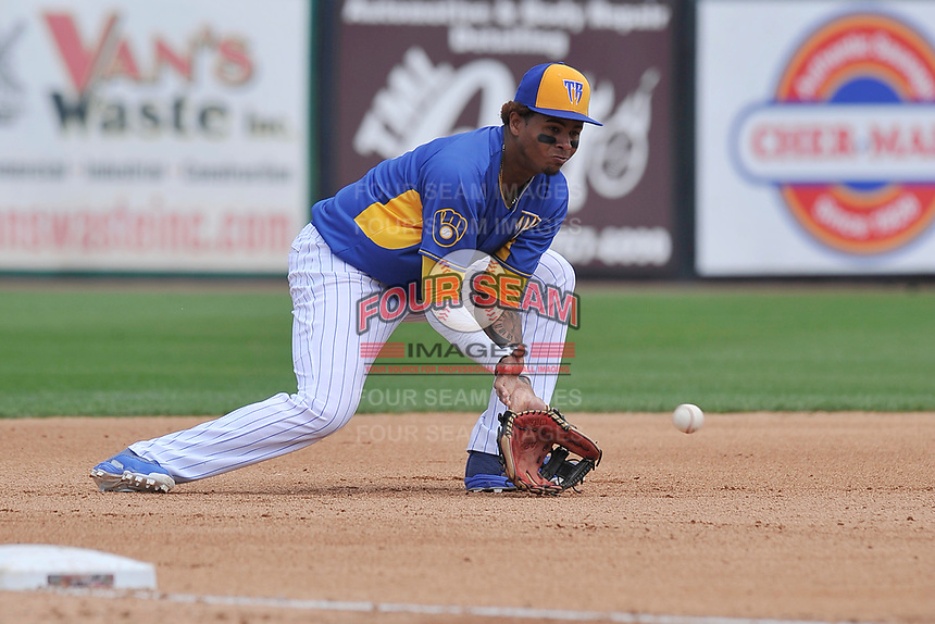 Wisconsin Timber Rattlers third baseman Gilbert Lara (11) fields a ground ball during a game against the Quad Cities River Bandits at Fox Cities Stadium on June 27, 2017 in Appleton, Wisconsin.  Wisconsin lost 6-5.  (Dennis Hubbard/Four Seam Images)