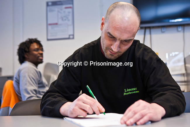 A prisoner working on a project in the computer room. Open University are working with prisoners in the education department at HMP Featherstone.