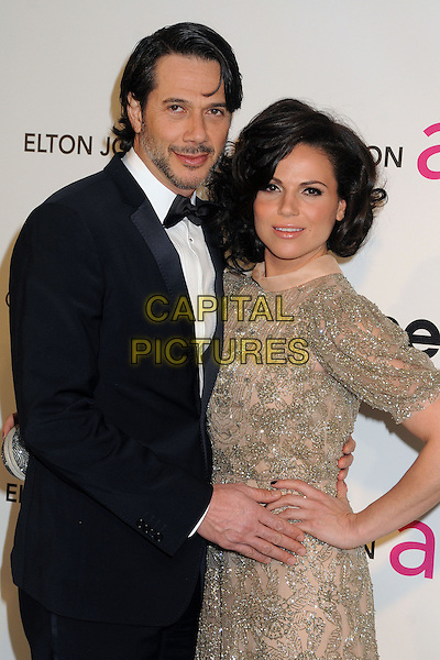 guest & Lana Parrilla.21st Annual Elton John Academy Awards Viewing Party held at West Hollywood Park, West Hollywood, California, USA..February 24th, 2013.oscars half length hand on hip beige silver beads beaded dress black suit tuxedo beard facial hair .CAP/ADM/BP.©Byron Purvis/AdMedia/Capital Pictures.