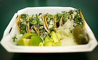 A plate of Carne Asada tacos with fired onions, cilantro, and limes at Cilantros Taqueria in Dallas, Texas, Thursday, September 17, 2009. .