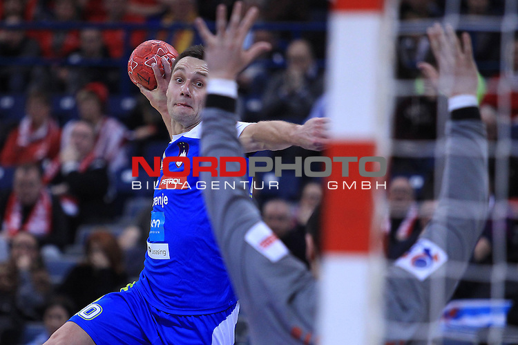 Luka Zvizej of Slovenia shoots the ball during the Men's European Handball Championship match for the fifth place between Macedonia and Slovenia in Belgrade January 27, 2012.<br /> <br /> Foto &copy;  nph / PIXSELL / Antonio Bronic